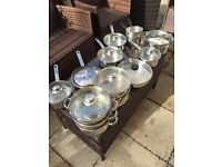 Full set of clean stainless cooking pans x11