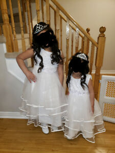 Flower girl dress, worn once..size 6,10, 12..each come with a ti