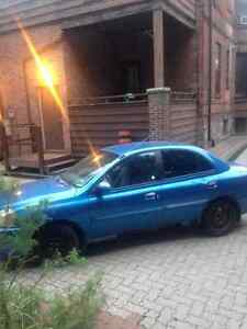 Kia Rio 2003, Rusted and Worn, but tough and loved