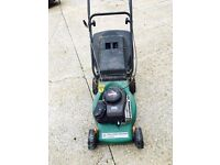 Perforce Power Lawnmower. Briggs and Stratton motor.