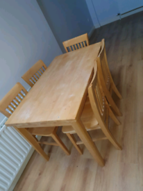 52. Light oak table and chairs