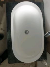 Large wash basin with marble top