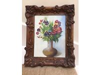 Antique oil painting of flowers in ornate frame. Signed.