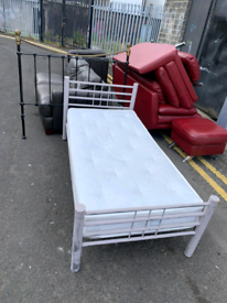 19. Metal bed frame and mattress