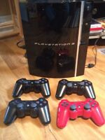 PS 3 (30 games, guitar and drums & 4 remotes)