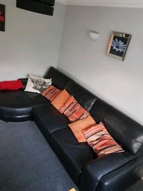 Dfs Black large leather sofa