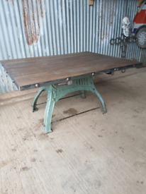 INDUSTRIAL CAST IRON AND OAK DINING TABLE