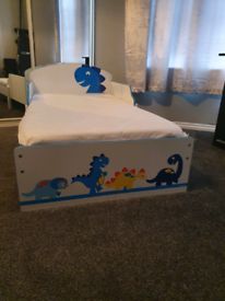 Toddler's dinosaur bed with washable mattress
