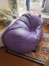 Large purple beanbag lounge with new beans