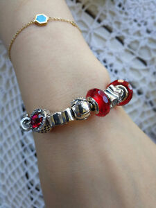 Panxxxx bracelets ( Pink, Blue and Red set, with 10 charms)