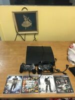 PS3 160gb + 4 games + 2controllers