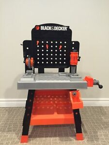 Kids play black & decker play bench.
