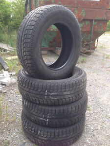 Four 215 65 R16 Michelin X-Ice Snow Tires