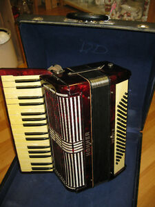 Accordian -- FROM PAST TIMES Antiques & Coll - 1178 Albert St