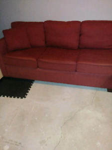 Mint Condition Red Couch and 6 Wood Table Chairs