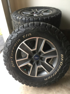 4 Tires on Ford branded rims sensors and lock nuts included