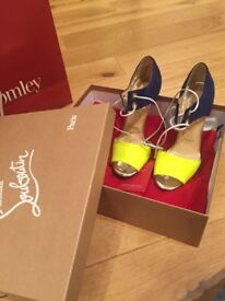 Brand new boxed Louboutins