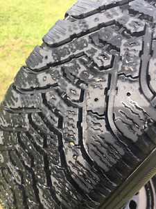Goodyear Nordic Snow Tires on GM rims with wheel covers
