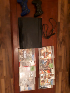 PS3 with 2 contollers + games