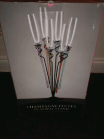 Champagne flutes in stand