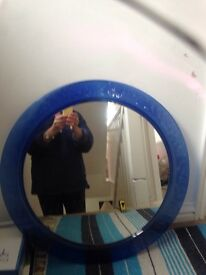 Circular mirror with blue glass surround