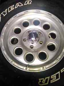 FORD RIMS AND GOODYEAR TIRES