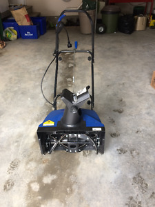 """Snow Joe"" snow thrower"