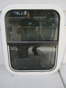 Travel trailer window tinted glass with screen opening