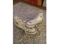 Size 5 white high tops. Converse
