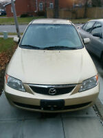 2002 Mazda Protege Sedan LOW KMS $1000 READY TO GO!! AS IS.