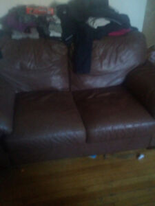 Brown leather htl love seat great condition 250 obo