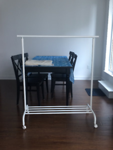 Rolling adjustable clothing rack