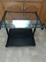 TV stand with glass shelf 32 inches wide by 22 inches high