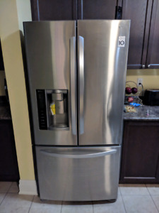 LG stainless steel french door fridge for parts.