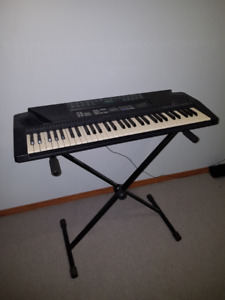 Kawai Electronic Keyboard and Stand.  Great starting instrument