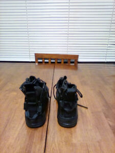 Brand new runners-black leather nike , zippers in back. size 6.5
