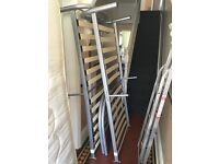 Single beds. Metal framed. Complete and undamaged. With mattresses.