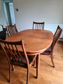 Extending wooden dining table and chairs
