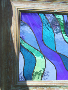 Stained glass in oversized wooden frame