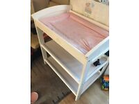 Baby changing table with a pink mat