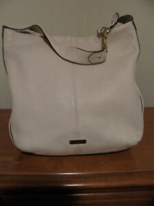 Genuine Coach Purses and Wallet with tags.