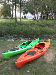 Kayaks with paddles and life jacket
