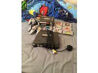 Nintendo 64 plus 2 controls and 10 games