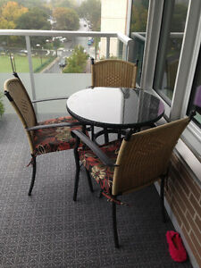 REDUCED Aluminium Table with four matching chairs & cusions