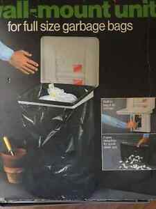 Garbage bag storage unit with wall mount