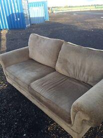 3 seater beige fabric sofa.