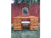 Solid pine dressing table in very good condition, comes with mirror and stool