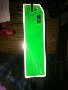 Lime green Xbox one and white 500 gb