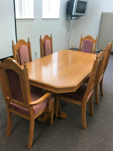 2 sets of dining room tables and chairs.