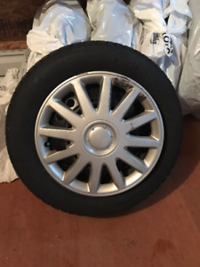Winter tire on rims with hubcaps